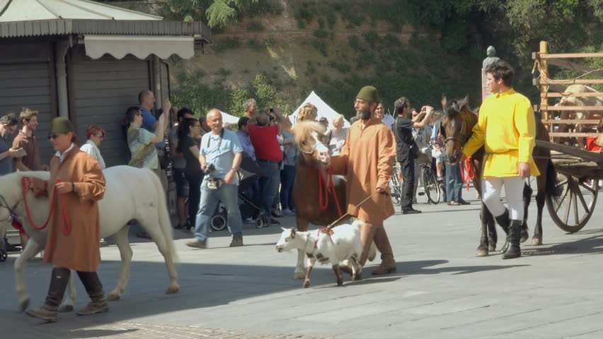 LUGO (RA), ITALY - MAY 20, 2018: actors and cattle walk in medieval parade under castle