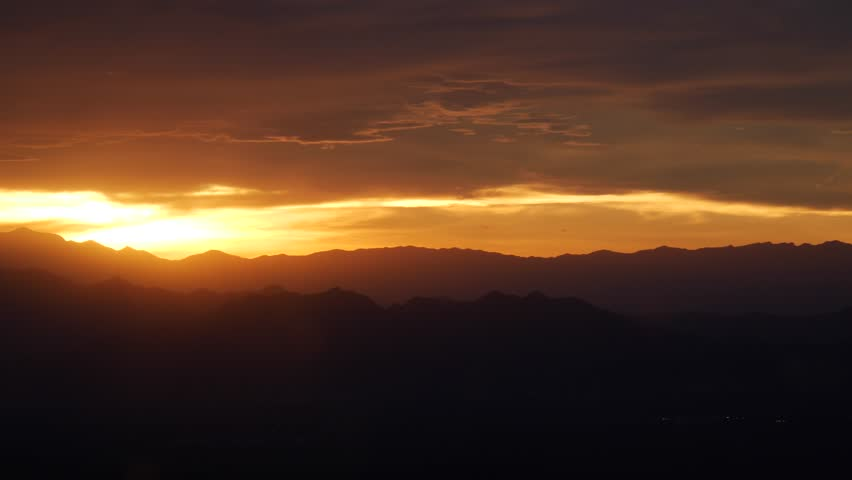Fiery orange sunset over the Grand Canyon USA from the Southern rim in a panorama view