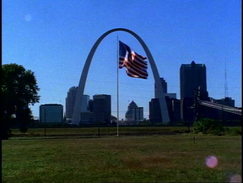 ST. LOUIS, 1999, St. Louis Arch, with skyline from Illinois side, big flag waving in center