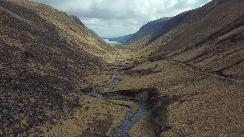 Aerial 4k footage of beautiful valley and river in mountains. Glenveagh national park in Ireland  | Shutterstock HD Video #1011555845