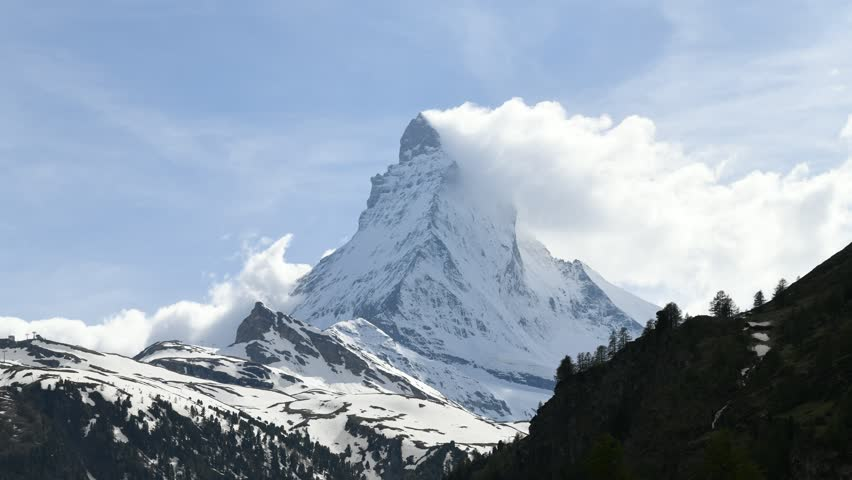 4k video Time lapse  very beautiful nature of  Matterhorn mountain , Switzerland Alps view from Zermatt , Moving cloud  #1011559565