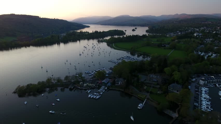 Aerial view over beautiful lake with mored boats and yachts on Windermere District UK Englands. Sunset over mountain landscapes in Britain.