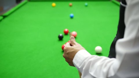 Snooker player using chalk cue during match - snooker game people in real competition match concept