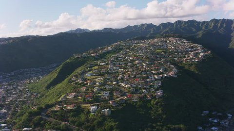 Oahu, Hawaii circa-2018. Aerial view of homes built along ridge on south shore of Oahu. Shot with Cineflex and RED Epic-W Helium.