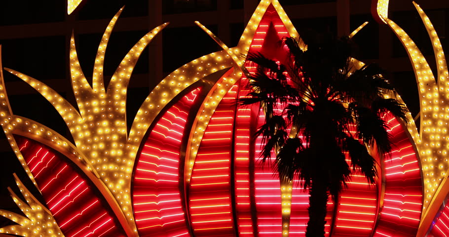Las Vegas, USA - May 18, 2017:  Neon lights flash and glow by the tourists in the gambling casino resort town of Las Vegas Nevada USA | Shutterstock HD Video #1011716825