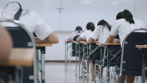 Asian students taking an exam in class room