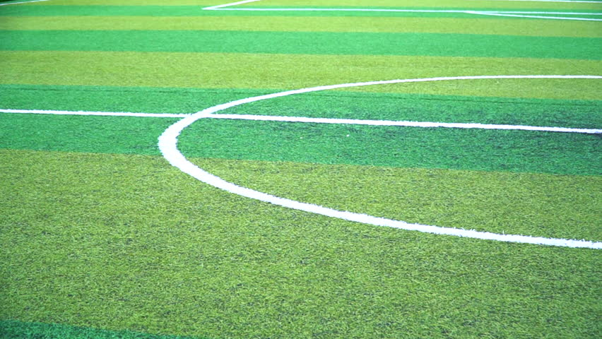 Pan motion of green soccer field.Beautiful artificial grass on the stadium.Abstract football turf ground background with white stripe line.Background,Sport,Texture Concept #1011733505