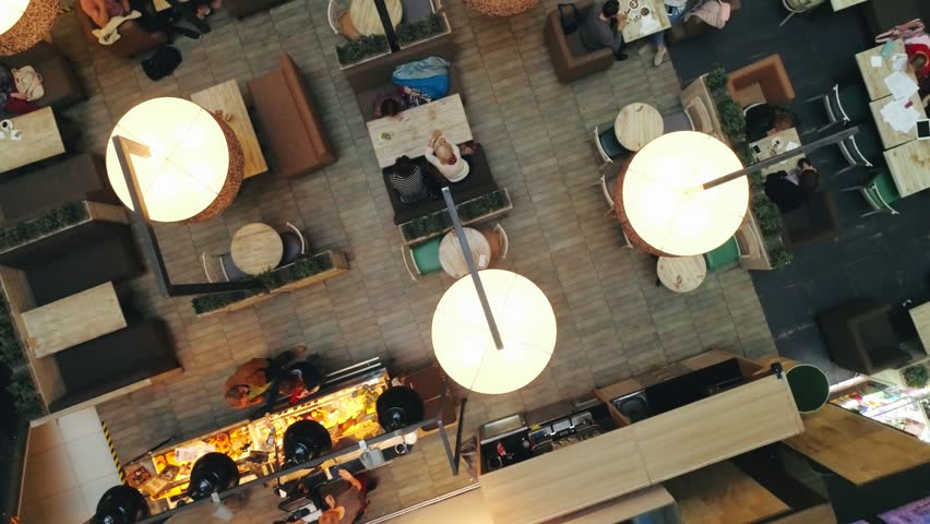 Cozy cafe in modern shopping center for snacking and resting visitors top view