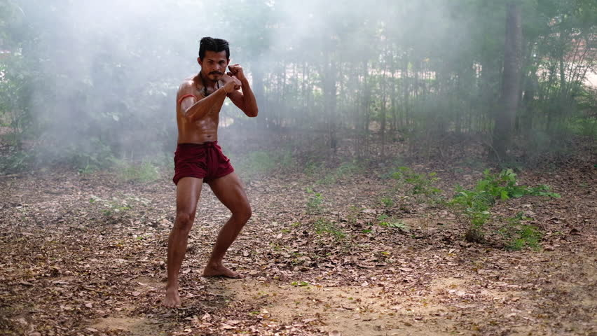 Thai warrior do Muay Thai danciing prepare for battle. Muay Thai (Thai Boxing) street fighter get ready in the battle ground Welcome to Thailand concept.Culture of thailand