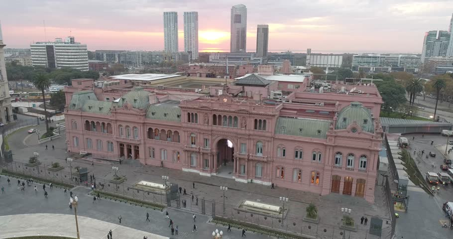 Aerial Drone Scene of May Square and Casa Rosada. The camera travels forward with a horizontal orbital rotation. Landscape of the pyramid and pink house, historic building. Buenos Aires, Argentina
