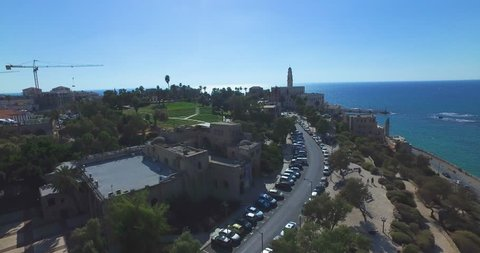 Tel Aviv - Jaffa / Aerial Drone footage. Fly from saint peter's church in Jaffa to Tel Aviv beaches and Skyline cityscape