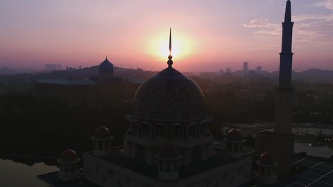 Silhouette Aerial view of Putrajaya Mosque at sunrise