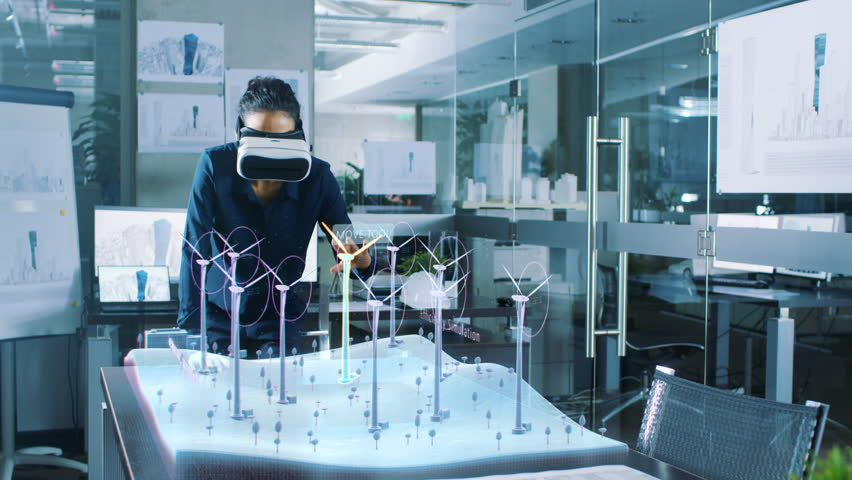 Futuristic Female Engineer Wearing Virtual Reality Glasses, Designs in 3D Field with Wind Turbines. Renewable Energy Expert Does Technological Efficiency Testing. Shot on RED EPIC-W 8K Helium Camera.