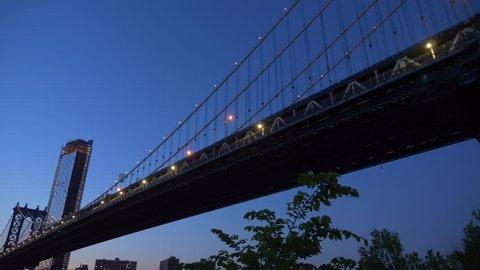 Beautiful View Of Manhattan Skyline Brooklyn Bridge and Manhattan Bridge At Sunset.