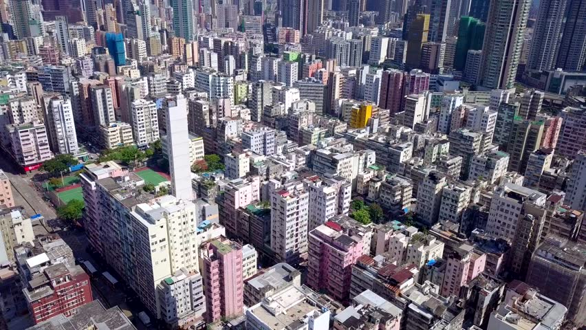 Kowloon city, Hong Kong 29 May 2018:- Drone fly over Hong Kong urban city | Shutterstock HD Video #1011951455