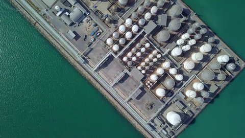 Aerial view oil depot, tank farm or oil terminal is industrial facility for storage of oil and petrochemical products ready for transport to further storage facilities, 4k