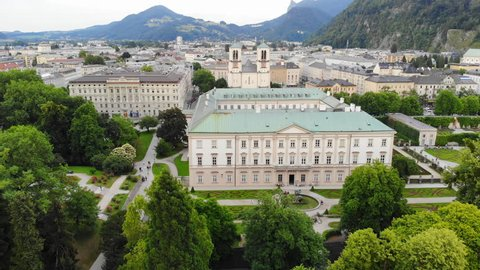 Aerial view of cityscape of old historic city of Salzburg, famous Mirabell Gardens and Palace in summer - landscape of Austria from above, Europe