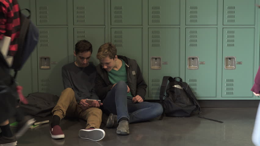 Medium shot of two students showing phone to each other | Shutterstock HD Video #1011995225