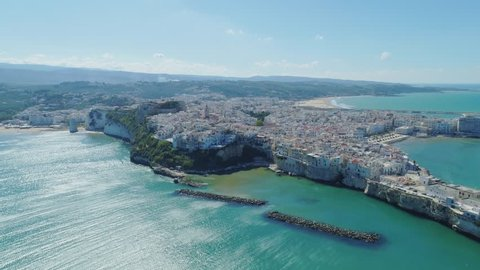 Polignano a Mare Apulia City Sea Coastline white houses ana castle in Italy Drone flight