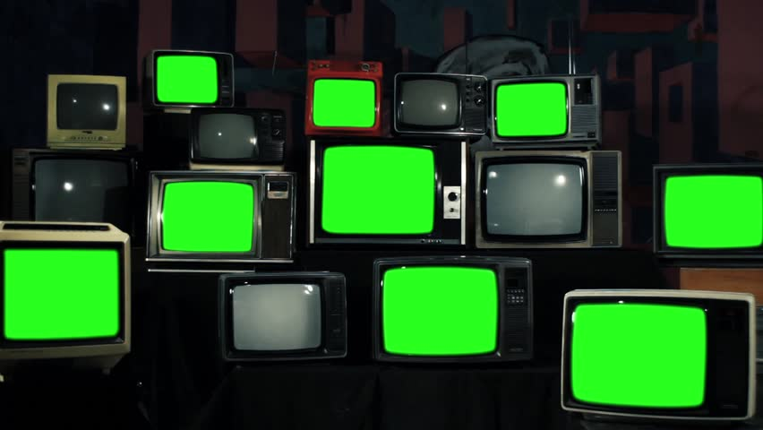 Many Tvs With Green Screens. Iron Tone. Aesthetics of the 80s. Zoom In. Ready to Replace Green Screens with Any Footage or Picture you Want.  | Shutterstock HD Video #1012046285