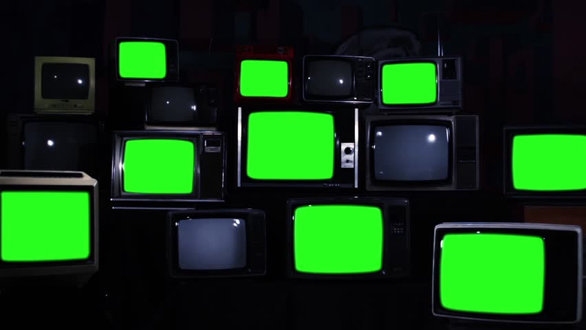 Many Tvs Green Screens Turning On. Zoom In. Blue Steel Tone. Aesthetics of the 80s. Zoom In.  Ready to Replace Green Screens with Any Footage or Picture you Want.  | Shutterstock HD Video #1012059935