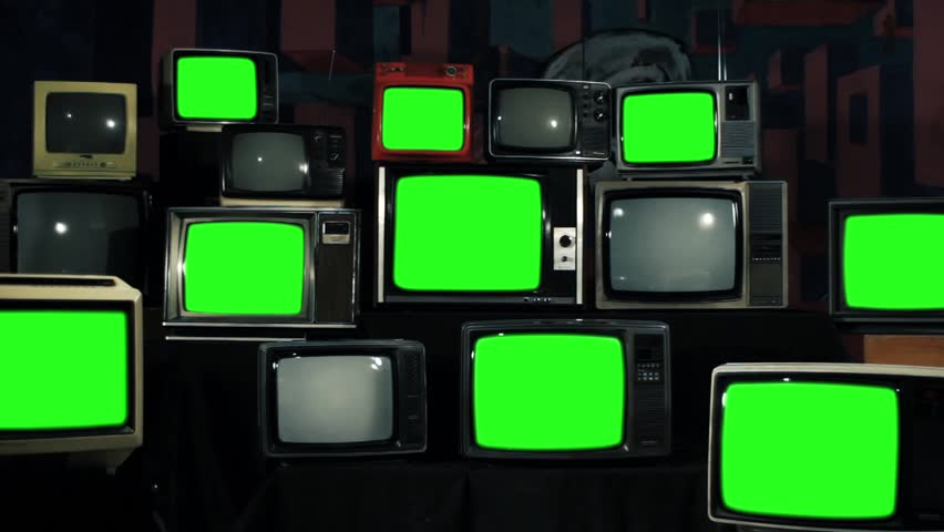 Many Tvs with Green Screens Turning Off. Iron Tone. Zoom Out. Aesthetics of the 80s. Ready to Replace Green Screens with Any Footage or Picture you Want.  | Shutterstock HD Video #1012062185