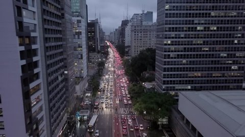 "4K UHD Dolly Travelling ""Zoom"" Out Aerial Shot of Avenue Between Buildings - Avenida Paulista, São Paulo, Brazil During Rush Hour"