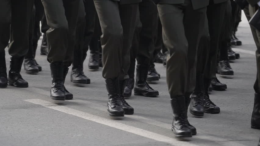 A close-up of the feet of military men who march on the parade on May 9, 2018 in a slow motion shot. Same clothes and shoes in public. Military march close-up in slowmotion shooting.