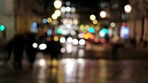 City at night blurred background with car lights. Out of focus background with blurry unfocused city lights.