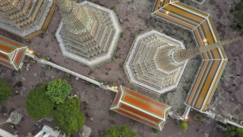 Bangkok Thailand beautiful Wat Phra Kaew temple. Top Down drone views in 4K. Golden light before sunset arial views of amazing Thai Buddhist temple. Unique  perspective from above straight down
