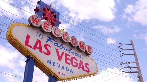 LAS VEGAS, NV - APRIL 10: Famous Welcome to Las Vegas sign on blue sky background 4k in Las Vegas sign in Las Vegas, Nevada on April 10, 2018.