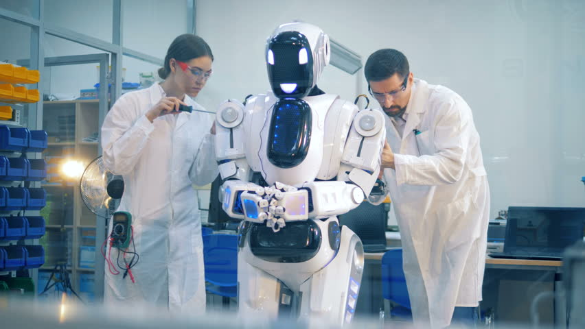 Human-like robot is going through a fixing procedure hold by two technicians