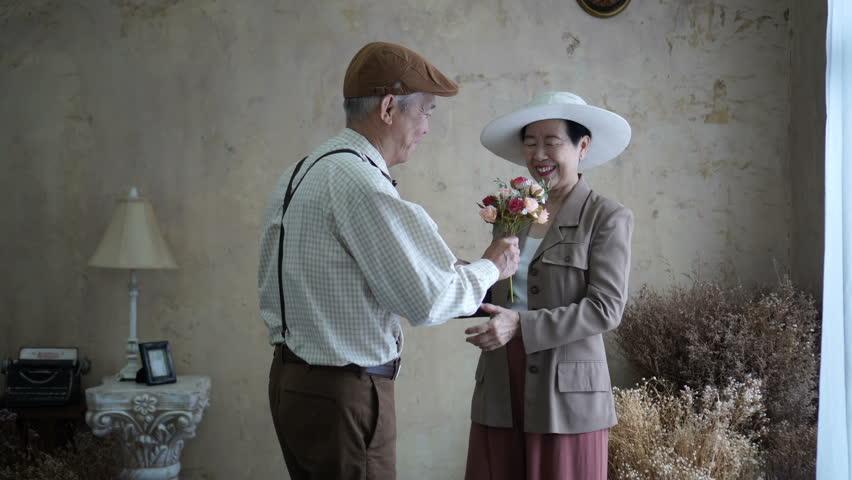 Asian senior couple celebrate Valentine's day flower dating love | Shutterstock HD Video #1012263425