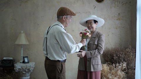 Asian senior couple celebrate Valentine's day flower dating love