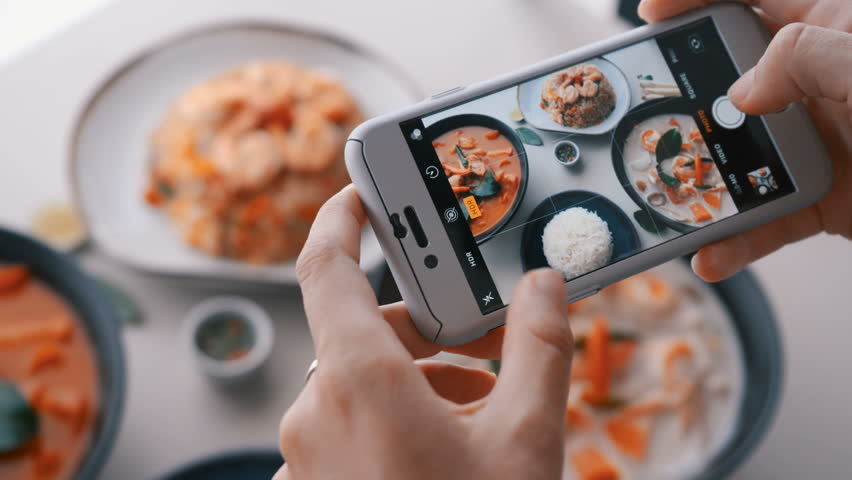 Female hands take photos of food by modern smartphone. Closeup. 4K. | Shutterstock HD Video #1012283375