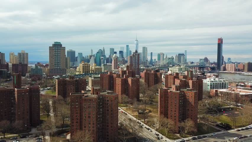 This video shows aerial views of  downtown Brooklyn, Dumbo, Vinegar Hill, New York Housing, and the Manhattan Bridge.  Skyline views of downtown Brooklyn and New York City are in the back drop.    | Shutterstock HD Video #1012294325