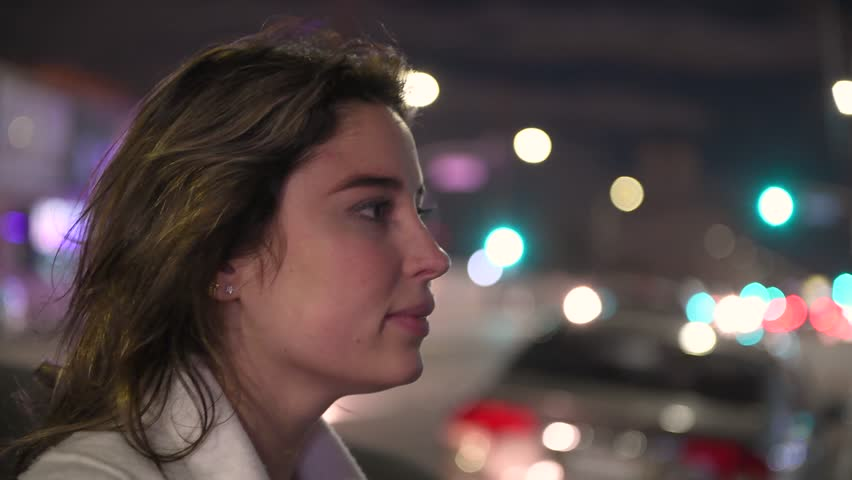 Beautiful woman thinking and looking to the city at night city street #1012313375