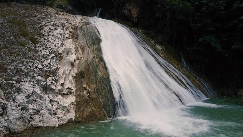 Aerial Drone Climbs a steep Haitian Waterfall