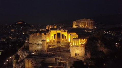 Athens Propylaia, Propylaea and  at night. 4k drone shot circling the Acropolis