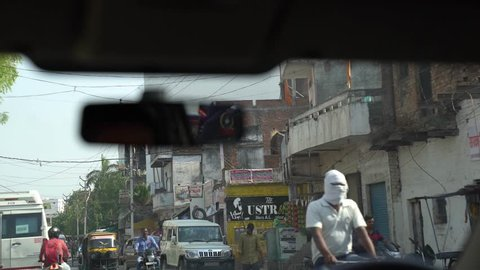 Street seen through car wind screen, Varanasi Banaras Benaras kashi city, Uttar Pradesh state / India filmed on 30th April 2018