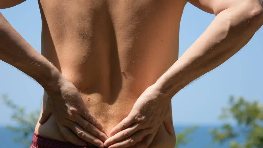 A sore lower back. Adult man.