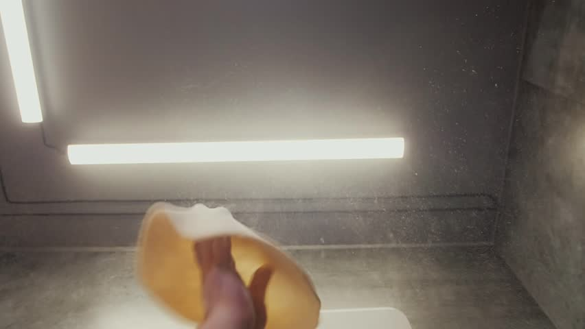 Chef spinning and tossing pizza dough in kitchen
