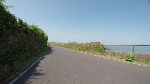 POV driving on beach road to Porlock weir in Somerset, England