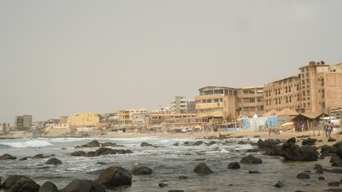 Beach with apartment buildings in Dakar, Senegal. Africa.
