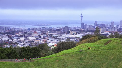 4K Time lapse : Tourist on Mount Eden with Auckland Cityscape Background, New Zealand.