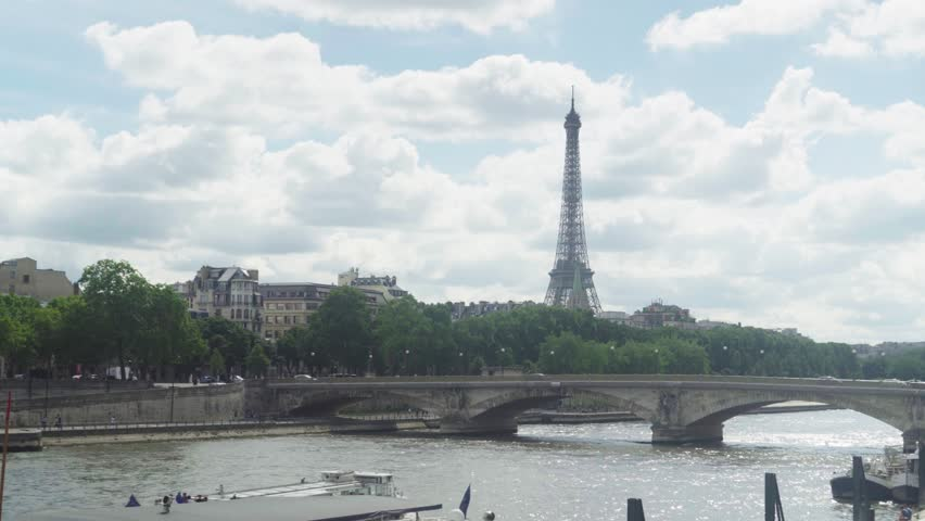 Paris, France - June 7, 2018: View of Eifel tower, American Church in Paris, Invalides Bridge, pleasure boat on the Seine | Shutterstock HD Video #1012420325