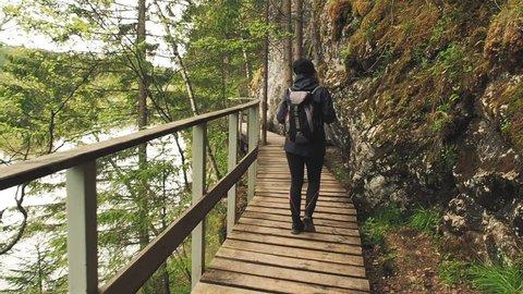 Hiking Girl Tourist Walking Hiking Trail National Park. Happy Tourist Enjoying Nature Freedom. Travel Tourism Hiking Trail Concept. Hiking Woman Travelling Backpack  Alone National Park In Autumn.
