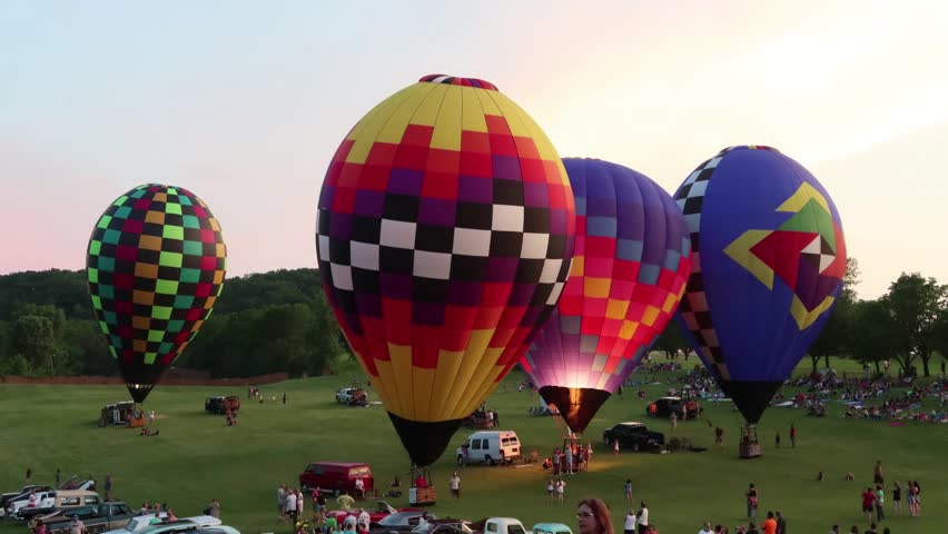 Galena, IL - June 16 2018: Hot air balloons light up the night at the annual Great Galena Balloon Race charity event with this years event raising money for Juvenile diabetes and camp Hertko Hollow.