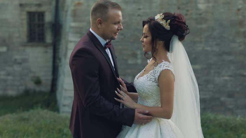 Lovely wedding couple making a kiss | Shutterstock HD Video #1012519025