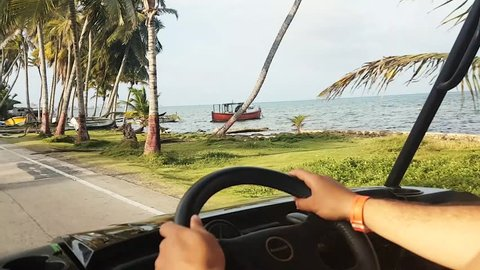 Scene from Colombia South America Slow Motion of San Andres Golf Cart driving round island